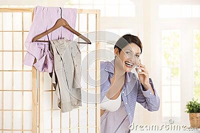Happy woman talking on mobile
