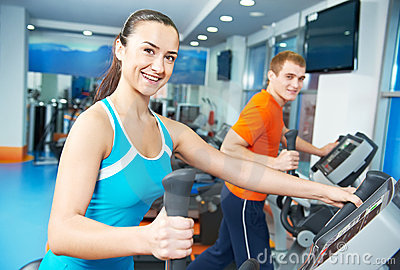 Happy woman with at training gym