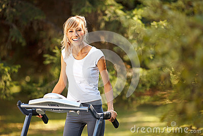 Happy woman on the treadmill