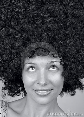 Happy woman with trendy curly hair style