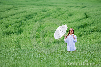 Happy woman with umbrella.
