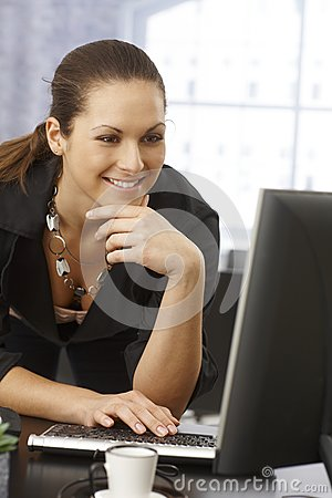 Happy woman using computer