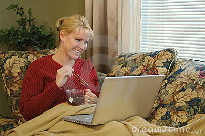 Happy Woman Using Laptop