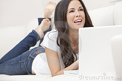 Happy Woman Using Laptop Computer