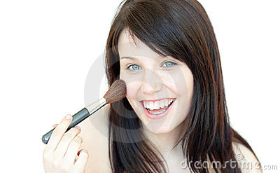 Happy woman using a powder brush