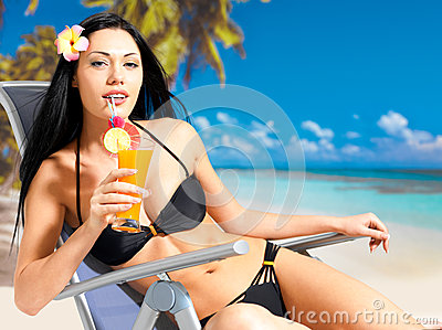 Happy woman on vacation on the beach