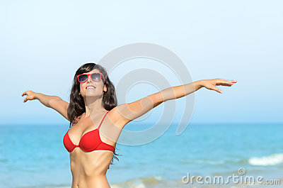 Happy woman vacations on beach