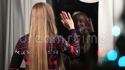 Happy woman waving hello from window on Xmas day stock video footage