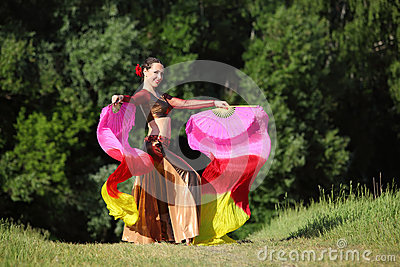 Happy woman wearing beautiful suit dances