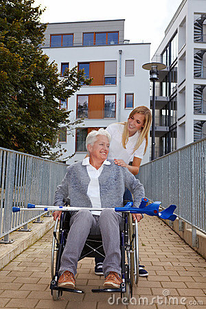 Happy woman in wheelchair on a ramp