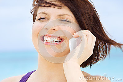 Happy woman with white phone