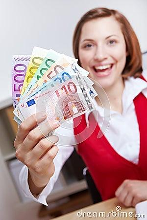 Happy woman winning Euro money