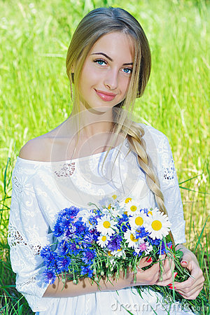 Free Happy Woman Wit Bouquet Of Chamomiles And Cornflowers Stock Images - 56696854
