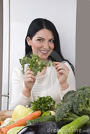 Free Happy Woman With Fresh Parsley And Vegetables Stock Images - 8433394