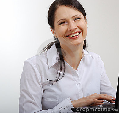 Happy woman working with a laptop.