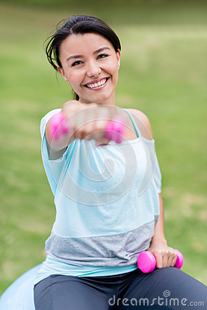 Happy woman working out