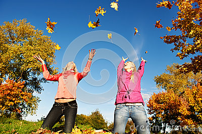 Happy Women at autumn outdoors