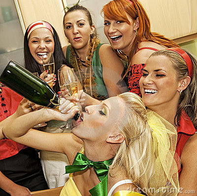 Happy women drinking champagne