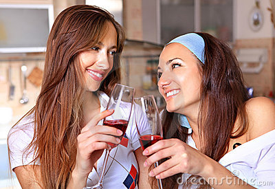 Happy women drinks wine