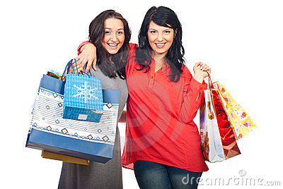 Happy women embracing at shopping