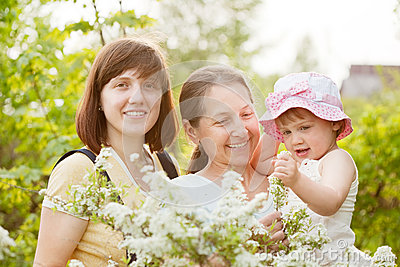 Happy women and kid at summer garden