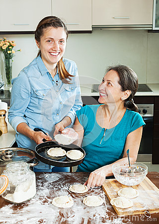 Happy women making pies