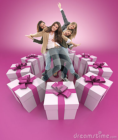 Happy women surrounded by gifts pink