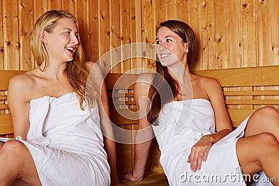 Happy women talking in sauna