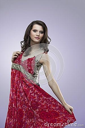 Happy women trying red flower dress