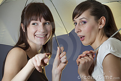 Happy women with umbrellas
