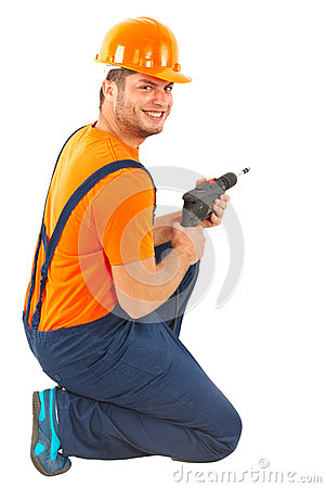 Happy worker with drill