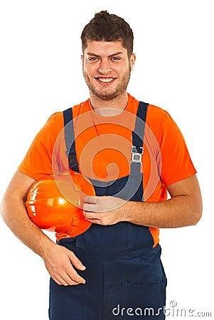 Happy worker holding helmet