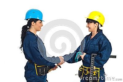 Happy workers women handshake