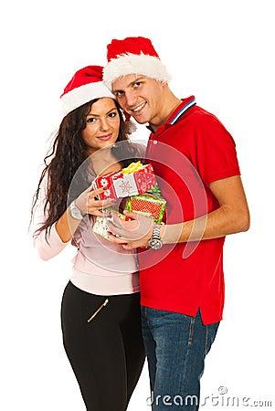 Happy Xmas couple holding presents