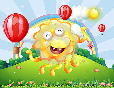 A happy yellow monster at the hilltop with a rainbow and floatin