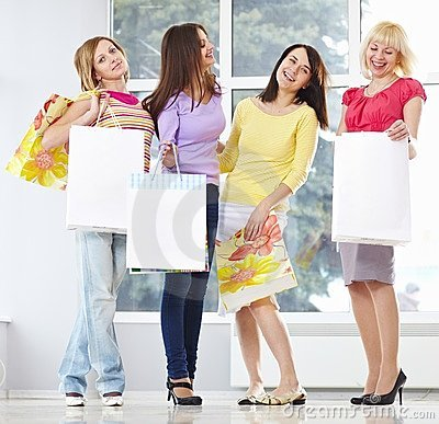 Happy young adults with shopping bags
