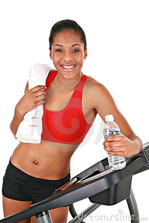 Happy Young African American Female by Treadmill