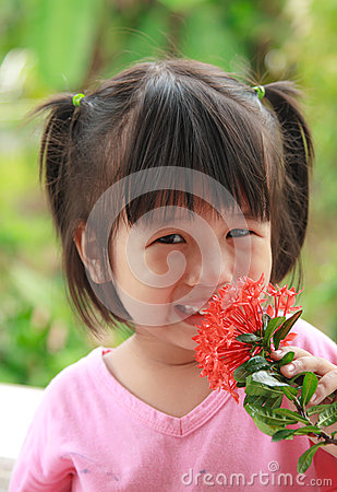 Happy young  asian girl smell flower