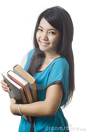 Happy young Asian student holding books