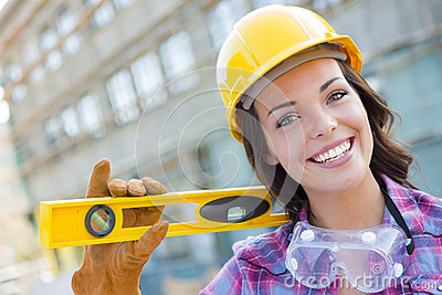 Happy Young Attractive Female Construction Worker Wearing Hard Hat and