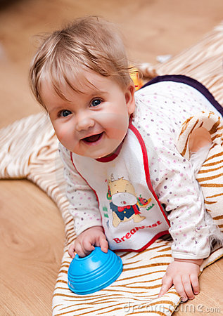 Happy young baby with toy