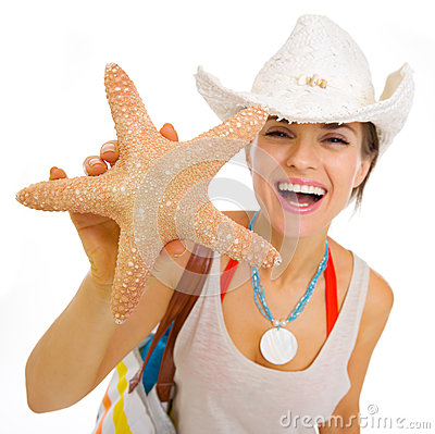 Free Happy Young Beach Woman In Hat Showing Starfish Royalty Free Stock Photos - 30028158