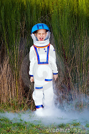 Happy young boy in a spaceman suit