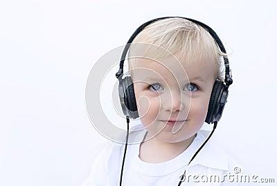 Happy young boy wearing headphones