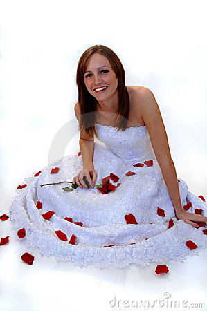 Happy young bride with rose petals