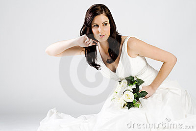 Happy young bride in wedding dress with bouquet