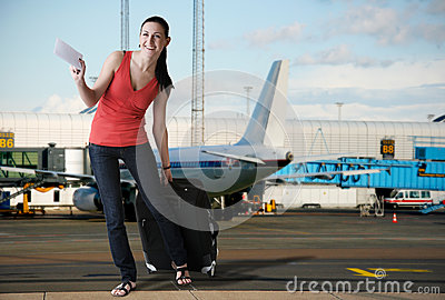Charming tourist woman in airport ready for boarding