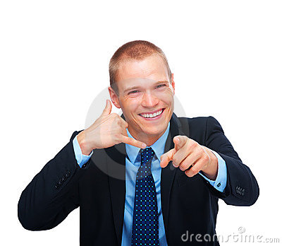 Happy young business man gesturing a call