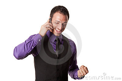 Happy young business man on mobile phone