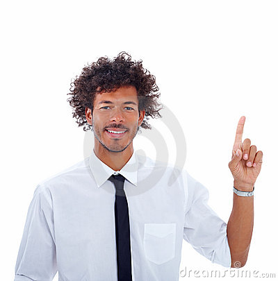 Happy young business man pointing upwards